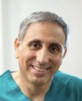 Офтальмолог Гай Кляйнман, глазной хирург
